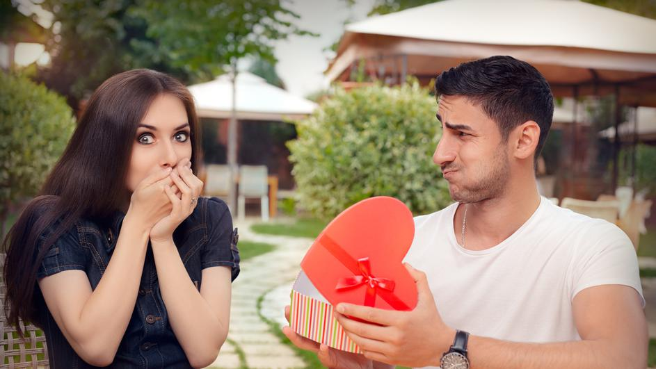 Happy Girl Receiving Heart Shaped Gift from her Boyfriend