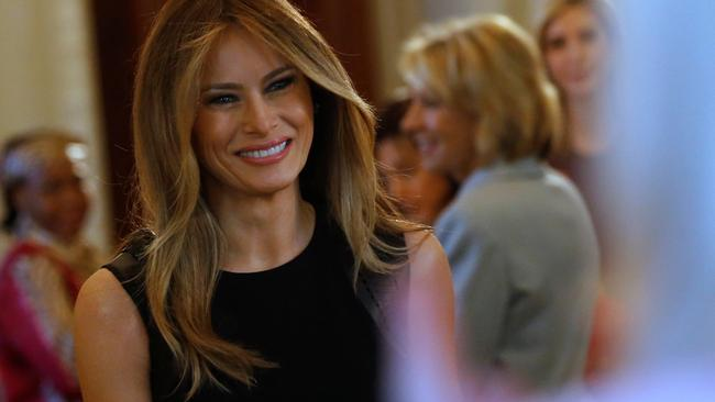 Melania Trump arrives to join her guests for an International Women's Day luncheon at the White House in Washington
