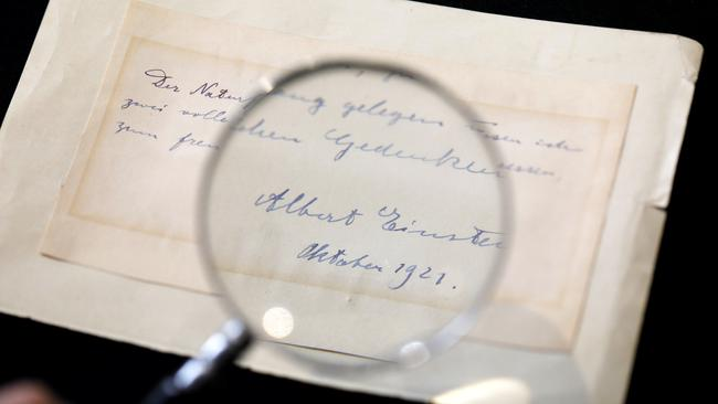A note written by Albert Einstein to Italian chemistry student Elisabetta Piccini in Florence, Italy, in 1921 is seen before it is sold at an auction in Jerusalem