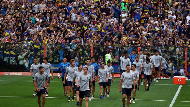 Boca Juniors' players enter the field during a training session open to the public ahead of their second leg Copa Libertadores final match against River Plate in Buenos Aires