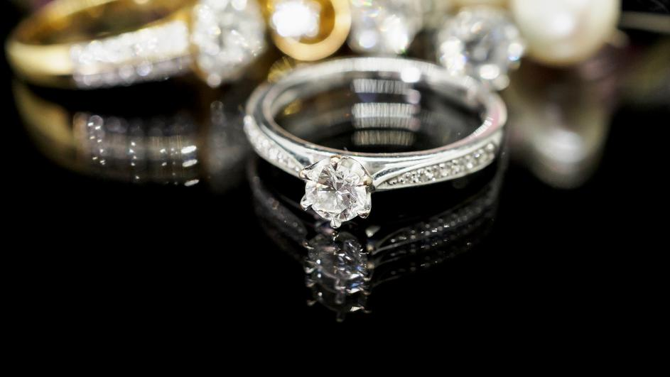 Jewelry diamond rings with reflection on black background