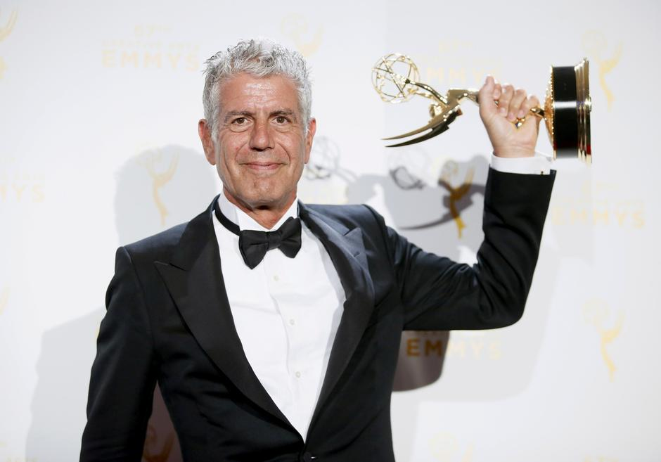 "FILE PHOTO: Anthony Bourdain poses with the outstanding informational series or special award for ""Anthony Bourdain Parts Unknown"" backstage at the 2015 Creative Arts Emmy Awards in Los Angeles 