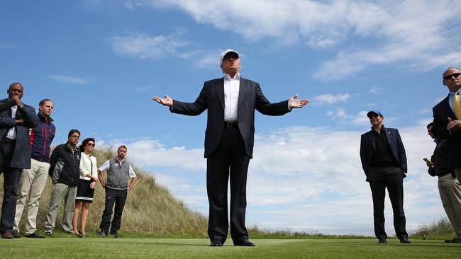 Republican presidential candidate Donald Trump speaks to the media on the golf course at his Trump International Golf Links in Aberdeen