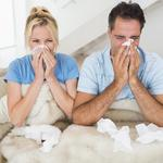 Couple suffering from cold in bed