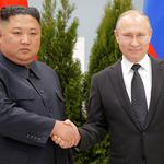 Russian President Vladimir Putin and North Korea's leader Kim Jong Un shake hands during their meeting in Vladivostok