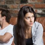 Angry couple avoiding talking after family fight