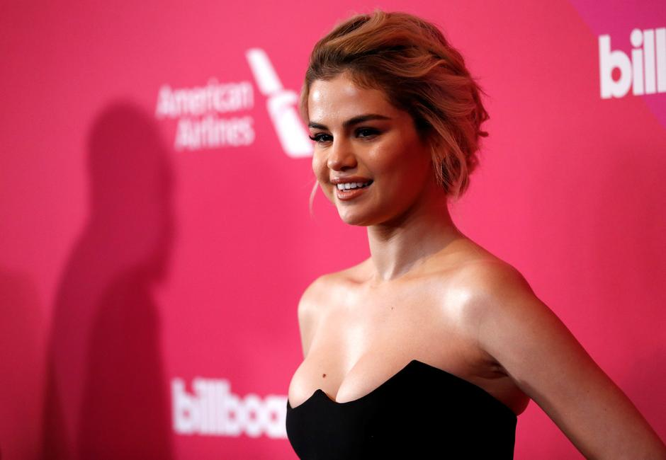 Singer Gomez poses at the Billboard Women in Music awards in Los Angeles | Autor: MARIO ANZUONI/REUTERS/PIXSELL/REUTERS/PIXSELL