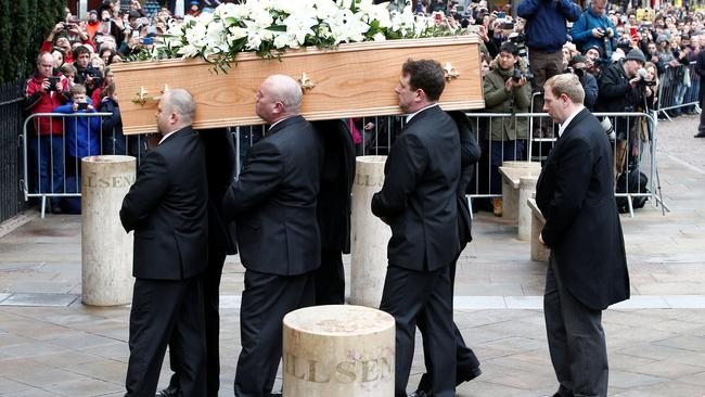 Pallbearers carry the coffin out of Great St Marys Church at the end of the funeral of theoretical physicist Prof Stephen Hawking, in Cambridge
