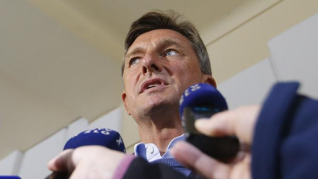 Presidential candidate Borut Pahor answers questions from the media during the presidential election outside a polling station in Sempeter pri Novi Gorici