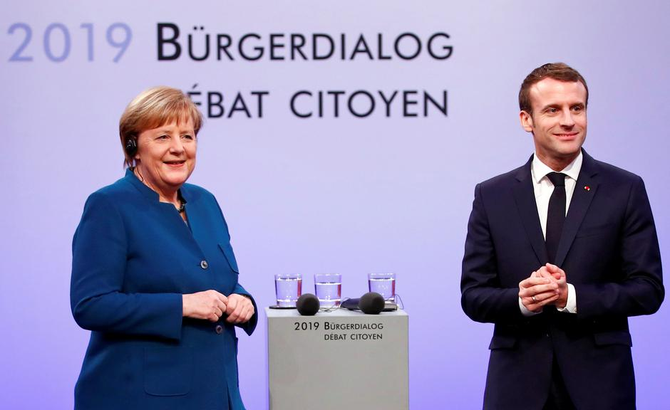 German Chancellor Angela Merkel and French President Emmanuel Macron attend a discussion with citizens, in Aachen | Autor: Wolfgang Rattay/REUTERS/PIXSELL/REUTERS/PIXSELL
