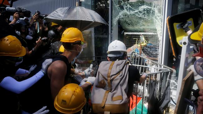 Protesters try to break into the Legislative Council building during the anniversary of Hong Kong's handover to China in Hong Kong