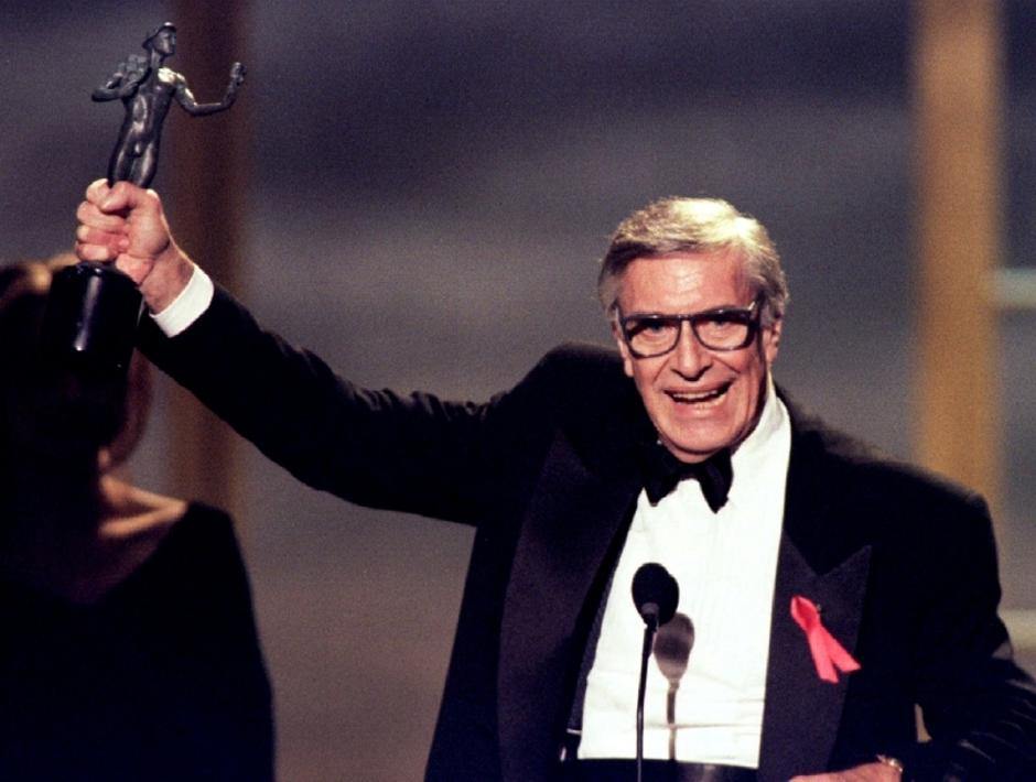 "FILE PHOTO - Actor Martin Landau holds the Screen Actors Guild Award he won for outstanding performance by a male actor in a supporting role for his role in the film ""Ed Wood"" at the first-ever televised awards show for the organization in Los Angeles 