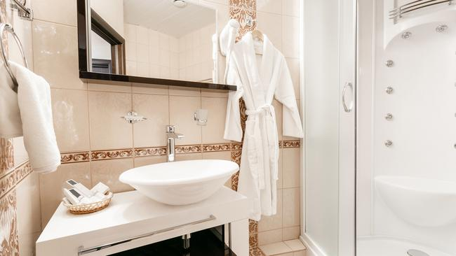 Bathroom Inside rooms of a apartment or hotel. Clean white towel