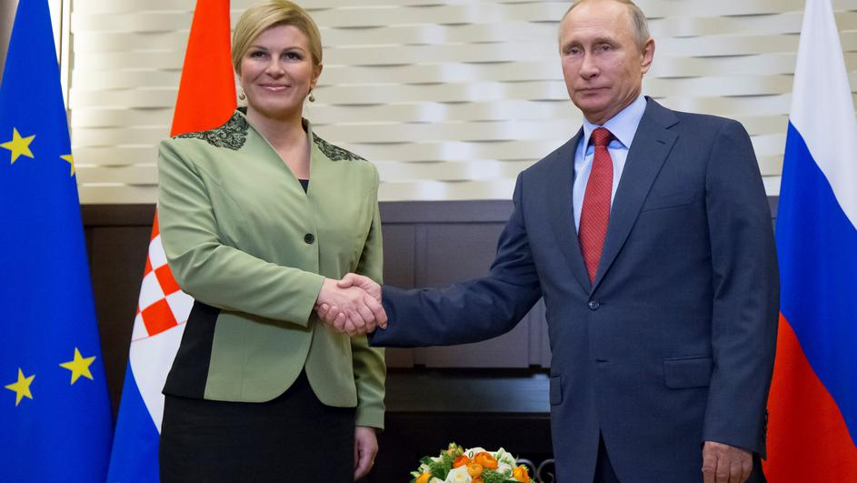 Putin shakes hands with Croatian President Kolinda Grabar-Kitarovic during their meeting in Sochi