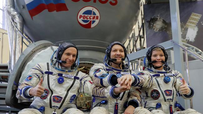Crew members of the International Space Station (ISS) pose for a picture as they attend the final qualification training for their upcoming space mission in Star City