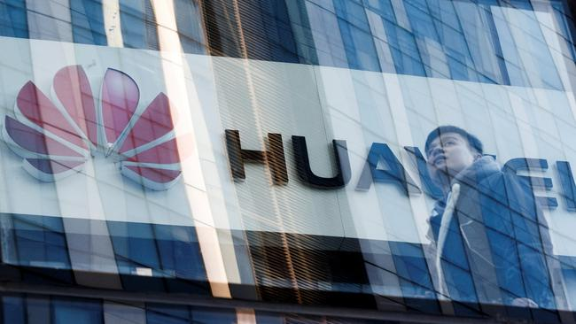 A man walks past a Huawei shop in Beijing