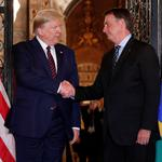 U.S. President Donald Trump shakes hands with Brazilian President Jair Bolsonaro before attending a working dinner at the Mar-a-Lago resort in Palm Beach, Florida