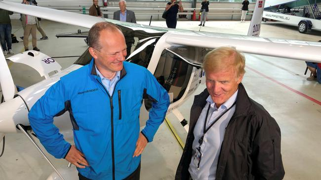 FILE PHOTO: Norwegian Transport Minister Ketil Solvik-Olsen and head of the Avinor Dag Falk-Petersen stand next to a two-seat electric plane made by Slovenian company Pipistrel at Oslo Airport