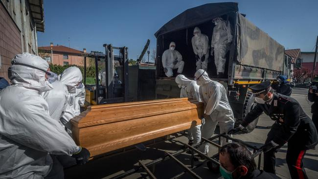 San Pietro bridge. Military and medical personnel of the Army together with the Carabinieri transport the coffins with the use of six trucks from a depot in Ponte San Pietro due to emergency COVID19 Coronavirus