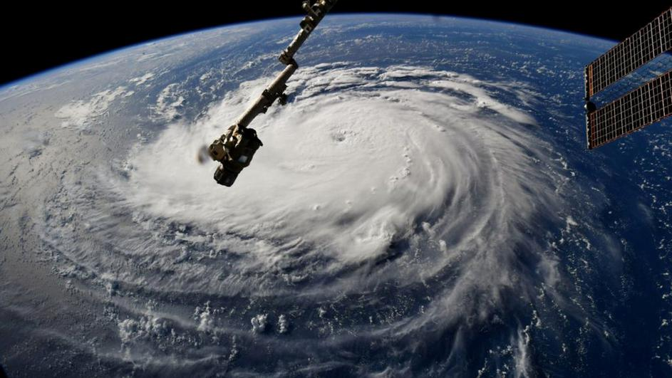 FILE PHOTO: NASA handout photo of Hurricane Florence churning in the Atlantic Ocean towards the east coast of the United States