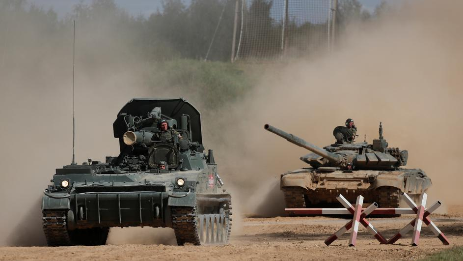 "A Russian 2S4 Tyulpan self-propelled mortar and a T-72 B3 tank perform during the annual international military-technical forum ""ARMY"" in Alabino"