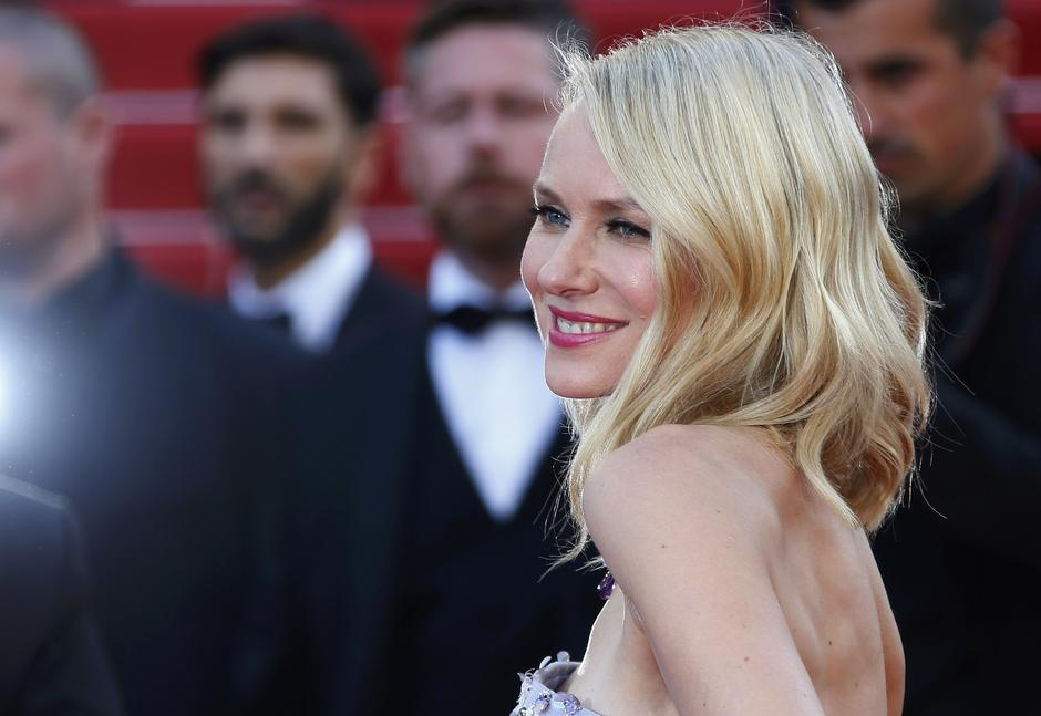 "Actress Naomi Watts poses on the red carpet as she arrives for the opening ceremony and the screening of the film ""Cafe Society"" out of competition during the 69th Cannes Film Festival in Cannes 