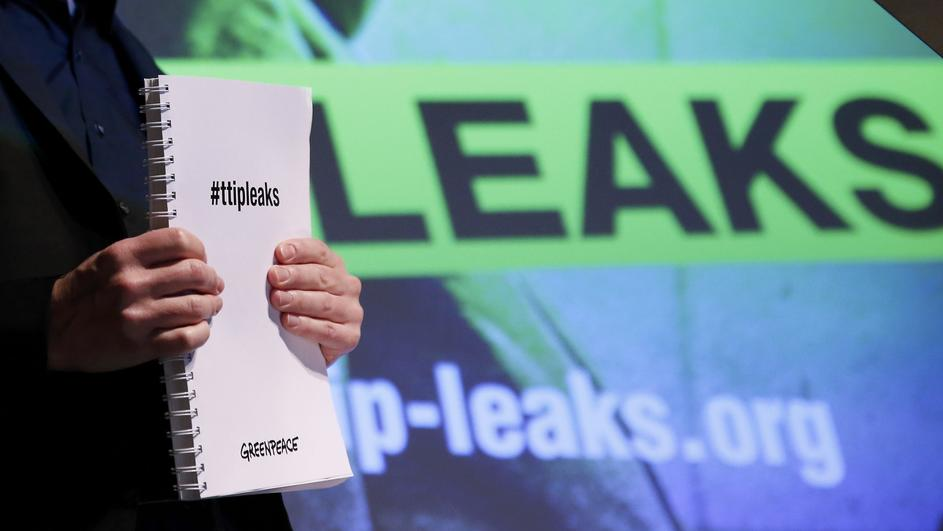 Gassner of Greenpeace holds a copy of the leaked TTIP negotiations in Berlin