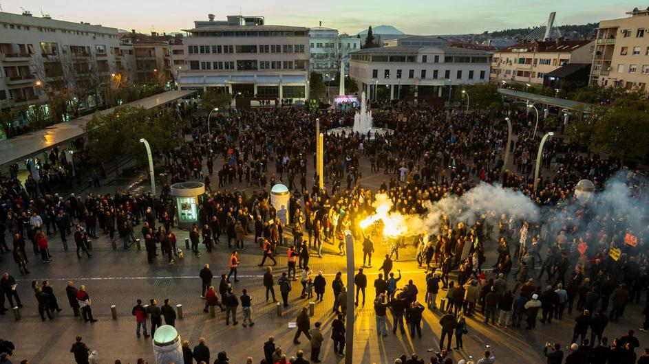 Protestants light flares as they arrive on civic protest in Podgorica