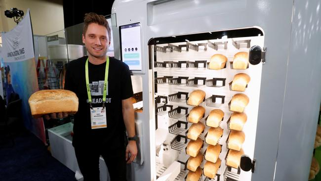 "Eric Wilkinson stands by the Wilkinson Baking Company Breadbot, a self-contained, automated bakery, at ""CES Unveiled"" during the 2019 CES in Las Vegas"