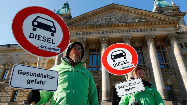 Greenpeace environmental activists protest in front of Germany's Federal Administrative Court in Leipzig