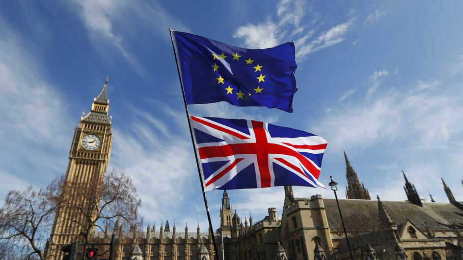EU and Union flags fly above Parliament Square during a Unite for Europe march, in central London