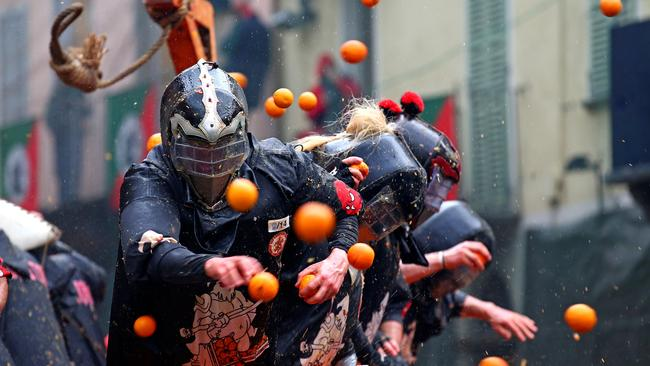 Members of rival teams fight with oranges during an annual carnival battle in the northern Italian town of Ivrea