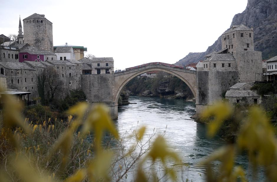 "Old Bridge is seen with poster which reads: ""The old bridge surfaced for the ones who love it"" in Mostar 