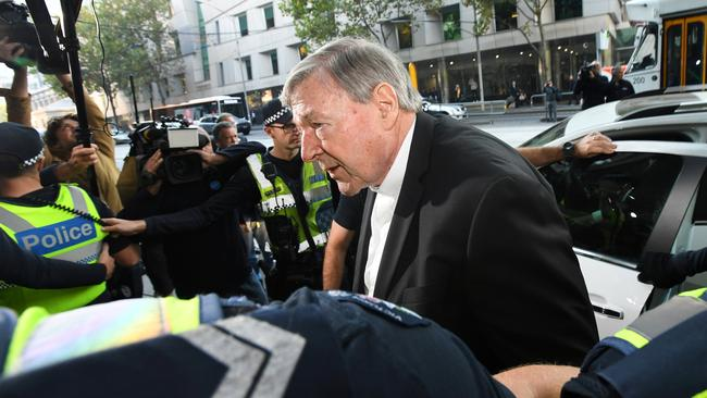 Cardinal George Pell arrives at the Melbourne Magistrates Court in Melbourne