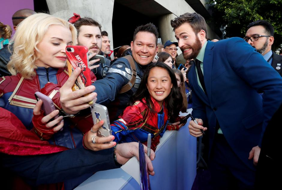 "Cast member Chris Evans poses with fans on the red carpet at the world premiere of the film ""The Avengers: Endgame"" in Los Angeles 