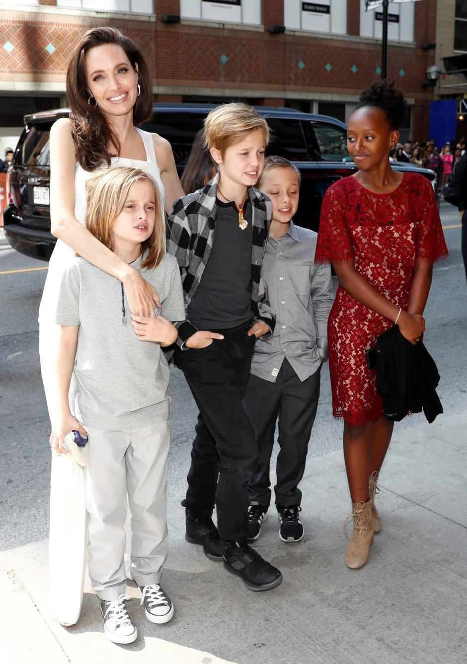 "Jolie arrives on the red carpet with her children for the film ""The Breadwinner"" during the Toronto International Film Festival in Toronto 