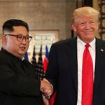 FILE PHOTO: President Donald Trump and North Korea's leader Kim Jong Un shake hands after signing documents during a summit in Singapore