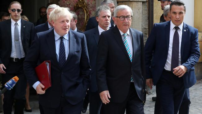 British Prime Minister Boris Johnson and European Commission President Jean-Claude Juncker leave after their meeting in Luxembourg
