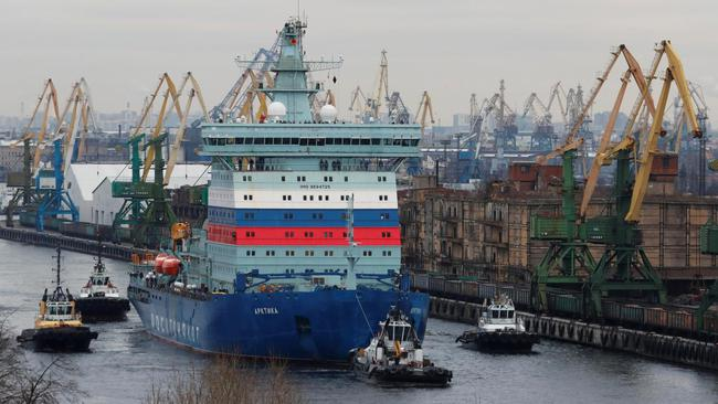 The nuclear-powered icebreaker Arktika is seen drawn by tug boats as it starts the sea trials, in Saint Petersburg