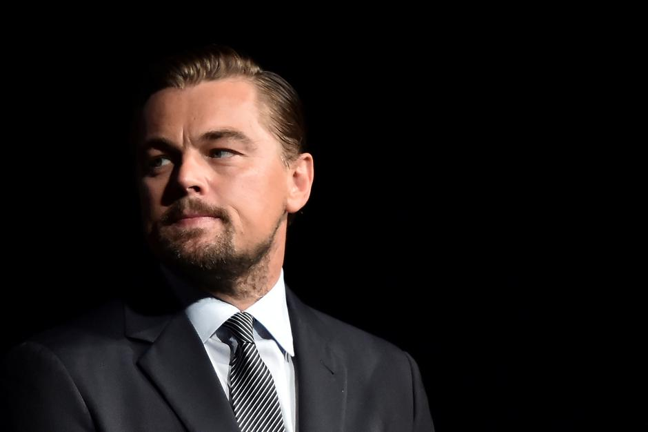 "FILE PHOTO: US actor Leonardo DiCaprio looks on prior to speaking on stage during the Paris premiere of the documentary film ""Before the Flood"" in Paris 