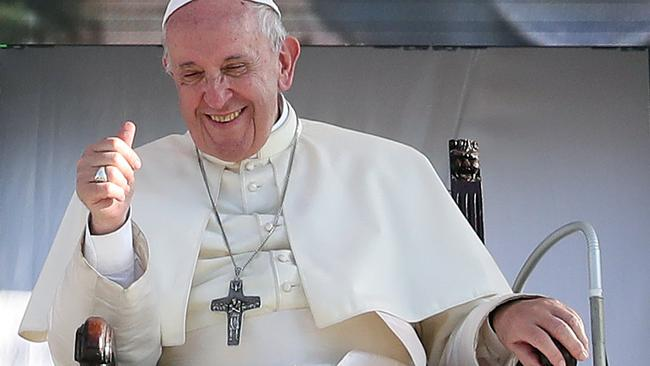 Pope Francis reacts as he meets with young people at the Politeama square in Palermo