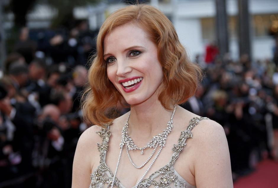 "Actress Jessica Chastain poses on the red carpet as she arrives for the screening of the film ""Money Monster"" out of competition during the 69th Cannes Film Festival in Cannes 