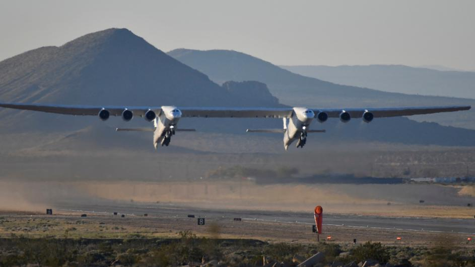 The world's largest airplane, built by the late Paul Allen's company Stratolaunch, makes its first test flight in Mojave