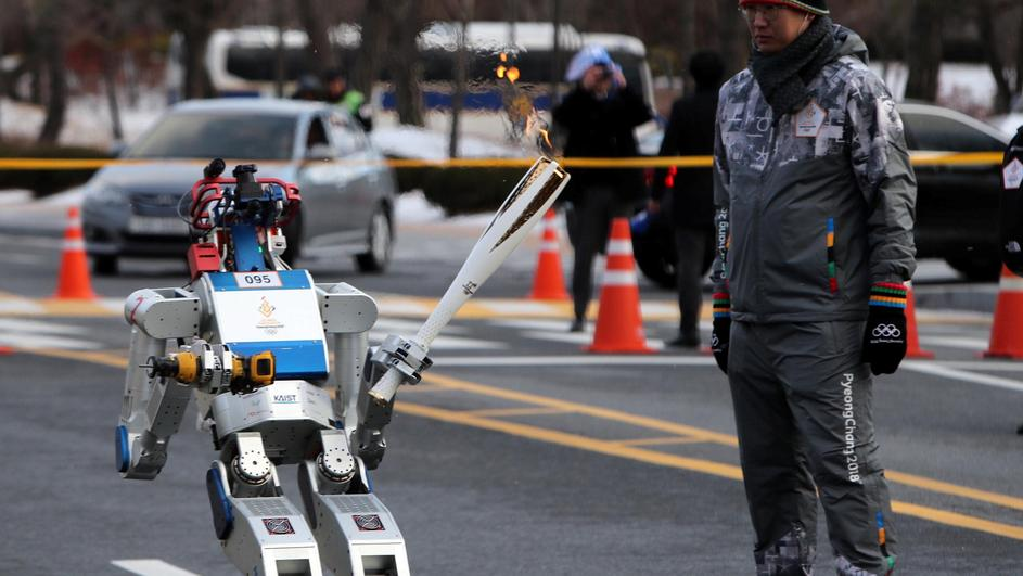 HUBO, a multifunctional walking humanoid robot, carries the Olympic torch at the Korea Advanced Institute of Science and Technology (KAIST) in Daejeon