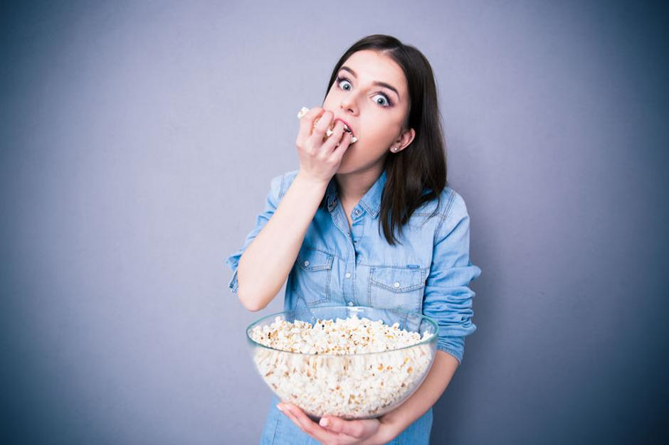 Young cute woman eating popcorn | Autor: Vadym Drobot