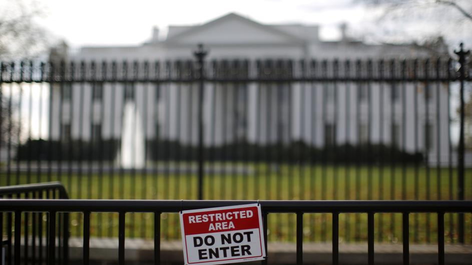 FILE PHOTO: A restricted area sign is seen outside of the White House in Washington