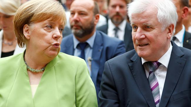 FILE PHOTO: German Chancellor Merkel and German Interior minister Seehofer attend an event to commemorate victims of displacement in Berlin
