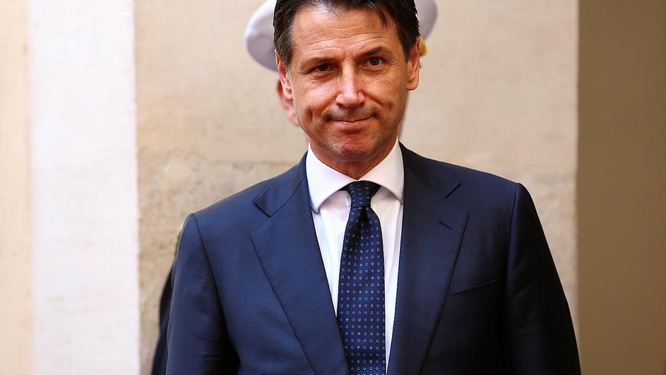 Italy's Prime Minister-designate Giuseppe Conte review the guard of honour at Chigi palace in Rome