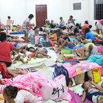 Photo by LGU Gonzaga Cagayan from social media shows people inside an evacuation centre in preparation for Typhoon Mangkhut in Cagayan