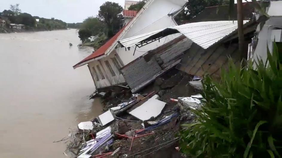 A destroyed house is seen after a tropical depression descended upon Daet, Camarines Norte